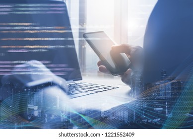 Software development, digital technology, big data, IoT Internet of Things concept. Coding software developer working on laptop computer and smartphone, computer code and big data VR screen