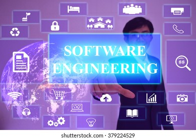 SOFTWARE ENGINEERING  concept  presented by  businessman touching on  virtual  screen ,image element furnished by NASA