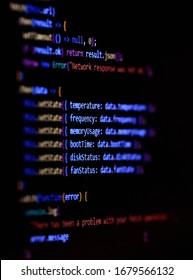 Software programming source code on computer screen.. Modern Javascript, typescript, ecma script code with React Framework. Vertical photo.