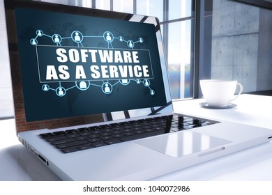 Software as a Service text on modern laptop screen in office environment. 3D render illustration business text concept.