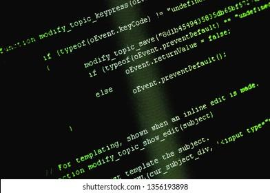 Software source code macro shot. Programming code background on computer screen