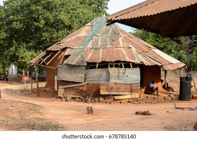 SOGA, GUINEA BISSAU - MAY 5, 2017: Unidentified local man sits on the porch of his house in a village of the Soga island. People in G.-Bissau still suffer of poverty
