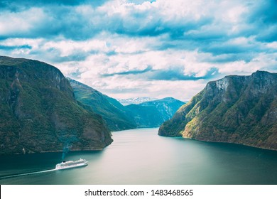 Sogn And Fjordane Fjord, Norway. Tourist Ship Ferry Boat Liner Floating In Amazing Fjord Sogn Og Fjordane. Summer Scenic View Of Famous Natural Attraction Landmark And Popular Destination In Summer.
