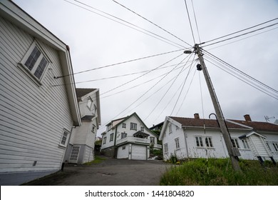 Sogndalstrand / Norway - June 20 2019: Sogndalstrand (also known Strondo), harbor village located at the mouth of the river Sokno. Utility pole supporting wires for electrical power distribution.