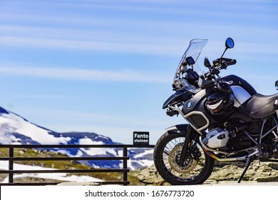 SOGNEFJELLET, NORWAY - JULY 7, 2018: BMW motorcycle in Sognefjell mountain area at the highest point Fantesteinen. National tourist route 55 Sognefjellet.
