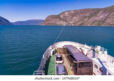 SOGNEFJORD, NORWAY - JULY 29, 2018: View over the Sognefjord and the boat deck of the Mannheller - Fodnes ferry.