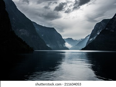 Sognefjord in Norway, the longest fjord in Europe, in cloudy weather, view from express boat