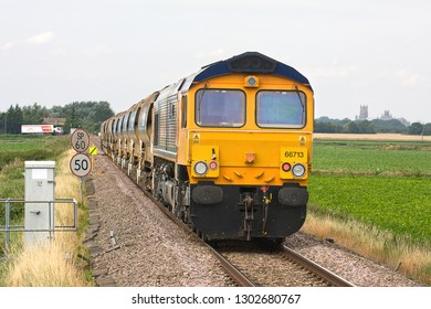 SOHAM, CAMBRIDGESHIRE, UK - AUGUST 19, 2012: GBRf Class 66/7 No. 66713 'Forest City' brings up the rear of the 6T65 Colchester to Whitemoor engineer's train, being led by GBRf Class 66 No. 66711.