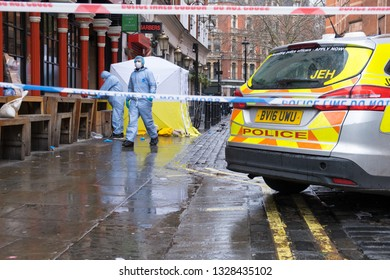 Soho, London, UK - March 3, 2019: Forensic officers at the crime scene outside in Romilly Street in Soho.