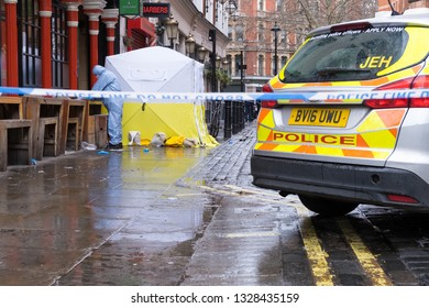 Soho, London, UK - March 3, 2019: A forensic officer at the crime scene outside in Romilly Street in Soho.