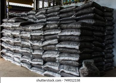Soil bag stack in warehouse. Organic Fertilizer Bag in the market.  (selective focus)