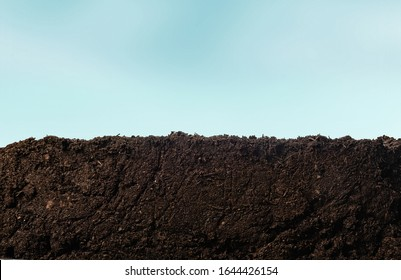 Soil or dirt section with sky