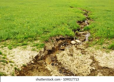 Soil erosion, damage of field by water.