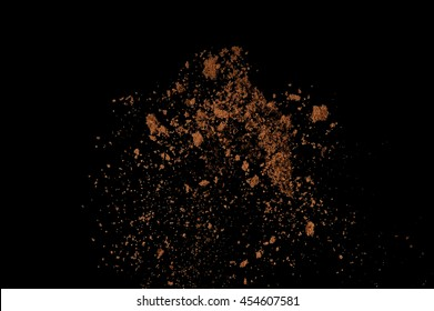 Soil explosion isolated on black background. Abstract cloud of brown ground.