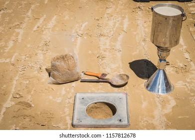 Soil field density test sand cone method calculation in construction site. field density test sand cone method calculation
