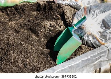 Soil for planting and garden shovel.