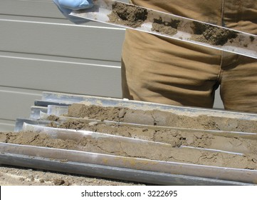 Soil Samples.  The cores from drilling of the earth has to be open to have access to soil samples for ecological assessment.