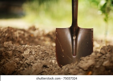Soil with shovel. Close-up, shallow DOF.