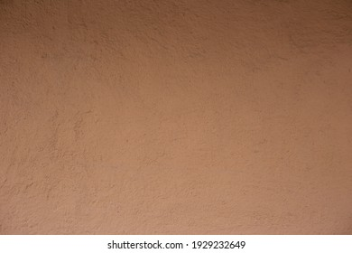 Soil wall texture of clay house structure. Mud background. Soft picture