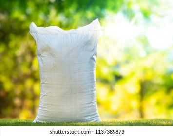 Soil white bag with nature green background