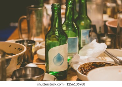 soju bottles and korean side dishes at the party in korea