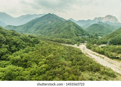 Sokcho, South Korea - June 08 2015 : A view of the valley with green mountains. Seoraksan is one of the best known national parks in South Korea.