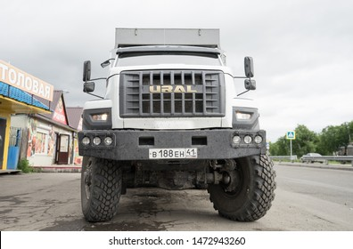 Sokoch, Kamchatka / Russia - July 29 2019: Front of new Ural truck. Six wheel off road all terrain vehicle of Russian origin. Transportation of military as well as civilians in harsh road conditions.