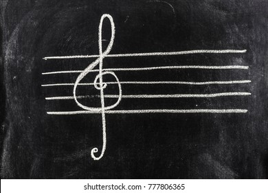 Sol key on pentagram sketched on blackboard
