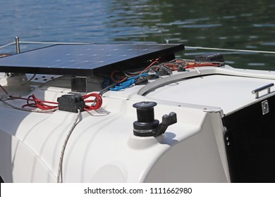 Solar battery for the development of electric current under the influence of sunlight mounted on the deck of a small sailing yacht. Electrification of the return on water during a tourist cruise.