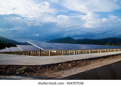 Solar cell farm in a cloudy day(focus at the solar panels). Alternative energy concept.