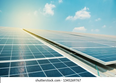 Solar cell in solar farm with green tree and sun lighting reflect, Alternative energy and sustainable energy, photovoltaic, Pure energy Concept.