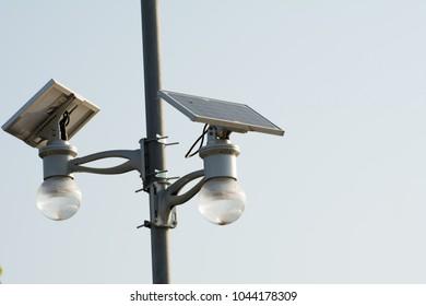 Solar cell lamp on sky background, Alternative energy from the sun