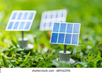 Solar cell models on green field, green energy concept.