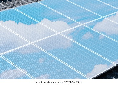 solar cell on the building roof with blue sky reflection