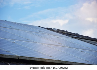 Solar cell on the roof top of the modern house in europe is help owner save energy and money. good investment for our future.background - copy space.