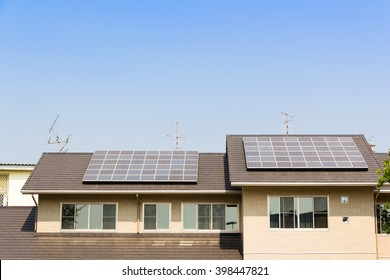 solar cell on top of house roof against blue sky  concept : clean energy, selective energy