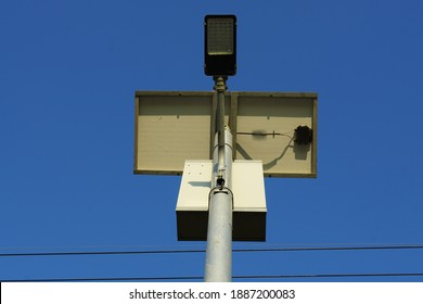 Solar cell panel on metal pole to support power for street lamp for saving energy. Clear blue sky background. Concept renewable energy, saving environment, solar cell.