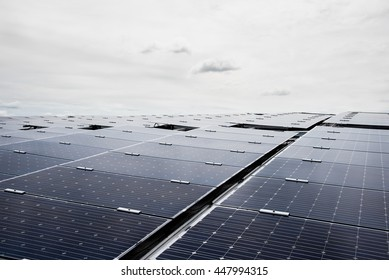 Solar cell panels in a photovoltaic power plant, Solar cell using renewable solar energy with solar panels on the metal sheet roof