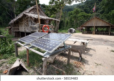 Solar cell panels in urban village, surin island, thailand