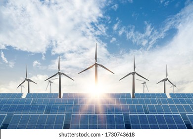 solar cell plant and wind generators under blue sky on sunset.Powerplant with photovoltaic panels and eolic turbine.clean energy and eco energy concept.