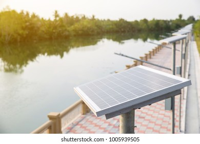 Solar cell plate on the walk way beside the river.  solar energy for converted to electric power. green energy concept. image for objects and article.