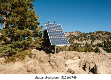 solar cell standing on the top of mountain.