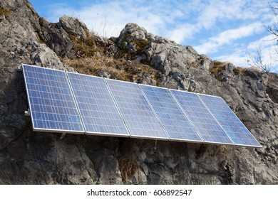 Solar cells on a rock wall in the mountains