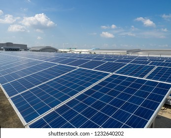 Solar cells panel outdoor on top roof of building, clean energy.