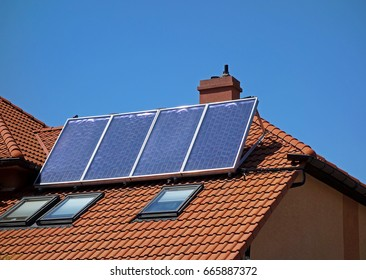 A solar collector on the roof of a family house