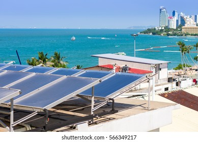 Solar Collector / Solar water heating system on the roof hotel  with landscape of sea view at Pattaya bay, pattaya city, Thailand