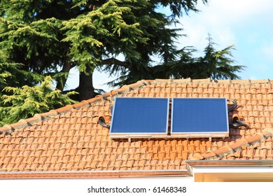 Solar collectors, used for hot water production, on a big roof