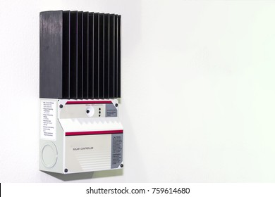 Solar Controller equipment for electric charge of solar energy industrial on white wall with copy space