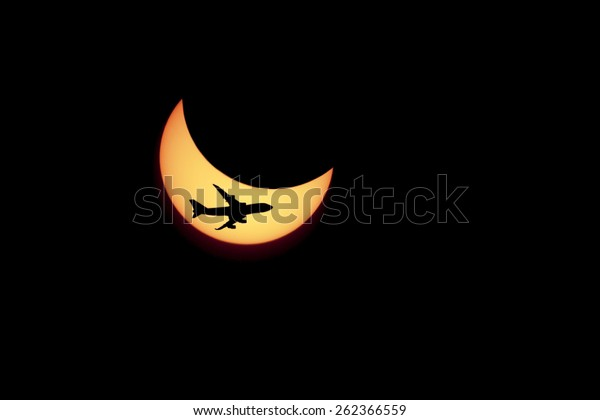 solar Eclipse and flying against the plane.