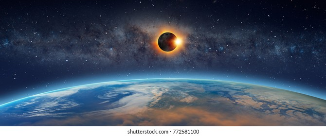 "Solar Eclipse  in front of the Milky Way galaxy ""Elements of this image furnished by NASA """